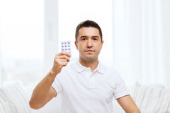 Man showing pack of pills at home Stock Photography