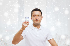 Man showing pack of pills at home Royalty Free Stock Images