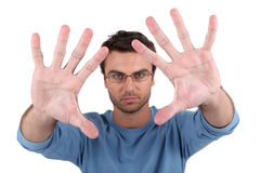 Man showing palms to camera Stock Images