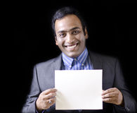 A handsome man showing a paper Royalty Free Stock Image