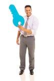 Man showing paper key Royalty Free Stock Photo