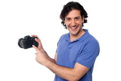 Man showing pictures stored in camera Stock Photography