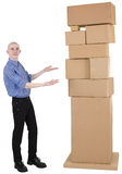 Man showing on pile cardboard boxes Stock Photos