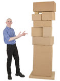 Man showing on pile cardboard boxes Royalty Free Stock Image