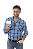 Man showing and pointing blank business card smiling happy Stock Image