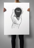 Man showing poster of Hand drawn light bulb Royalty Free Stock Images