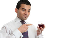 Man showing or presenting wine Stock Image