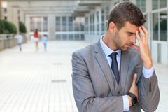Man showing repentance with his family leaving him in the background.  royalty free stock photos