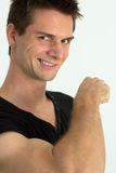 Man showing he's arm muscles. And smiling Stock Photography