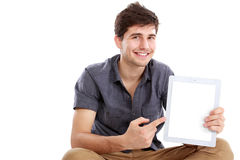 Man showing screen of digital tablet. Handsome Man showing screen of digital tablet Royalty Free Stock Image