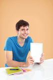 Man showing screen of digital tablet. Handsome Man showing screen of digital tablet Royalty Free Stock Photo