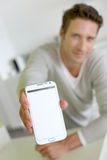 Man showing screen of smartphone Stock Image