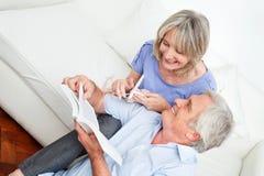 Man showing senior woman knitting Royalty Free Stock Photo