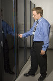 Man showing server room. Man showing internet company server room Royalty Free Stock Photos