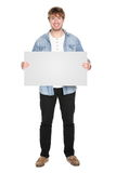 Man showing sign. Standing in full body. Casual young guy holding blank empty banner sign isolated on white background. Caucasian male model in his twenties stock photos