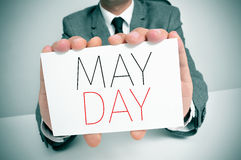Man showing a signboard with the text may day Royalty Free Stock Image