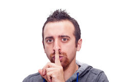 Man showing silent sign Royalty Free Stock Photo