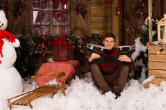 Man Showing Skates at Christmas Decorated House Royalty Free Stock Photography