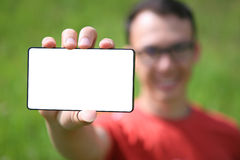 Man showing a smart phone Royalty Free Stock Images