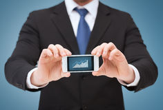 Man showing smartphone with graph on screen Royalty Free Stock Photo