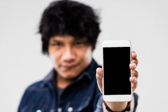 Man showing smartphone screen to you Stock Images