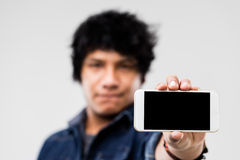 Man showing smartphone screen to you Royalty Free Stock Image