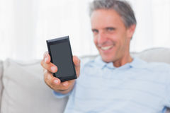 Man showing smartphone to camera Stock Photography