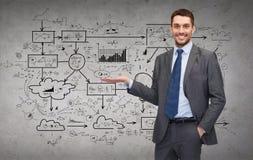 Man showing something big plan on concrete wall Stock Photos