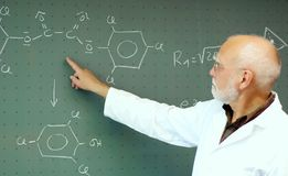 Man showing something on the blackboard. Professor showing something on the blackboard in the lecture Stock Photography