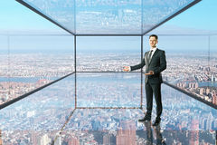 Man showing something in glass room Stock Photos