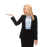Man showing something imaginary on her hand Royalty Free Stock Photos