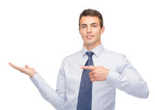 Man showing something on the palm of his hand Stock Photos