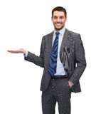Man showing something on the palm of his hand Royalty Free Stock Image