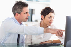 Man showing something to his coworker Stock Image