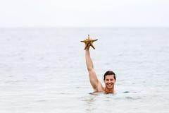 Man showing starfish Stock Photography