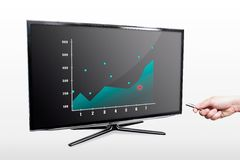 Man showing stock chart on tv Royalty Free Stock Images