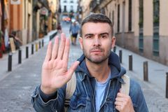 Man showing a STOP hand sign.  stock photography