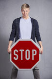 Man showing stop sign. Stock Photo
