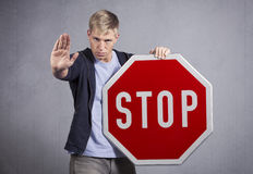 Man showing stop sign. Royalty Free Stock Images