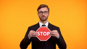Man showing stop sign, voting against race and gender discrimination at work. Stock photo royalty free stock photography