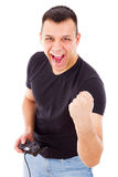 Man showing success playing video game with joystick Royalty Free Stock Photo