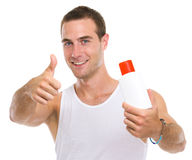 Man showing sun screen creme and thumbs up Stock Image