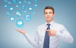 Man showing symbols on the palm of his hand Stock Photo