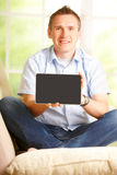 Man showing tablet Royalty Free Stock Photos
