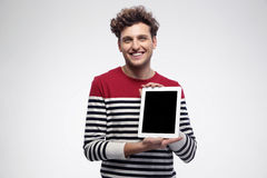Man showing tablet computer screen Stock Photos