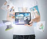 Man showing tablet pc with news Stock Photos