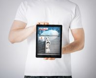 Man showing tablet pc with news Stock Images
