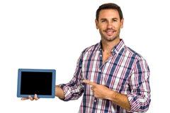 Man showing tablet screen at camera Royalty Free Stock Photo