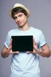 Man showing tablet screen smiling Royalty Free Stock Photo