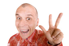 Man showing three fingers. Middle aged man showing three fingers isolated on white Stock Image
